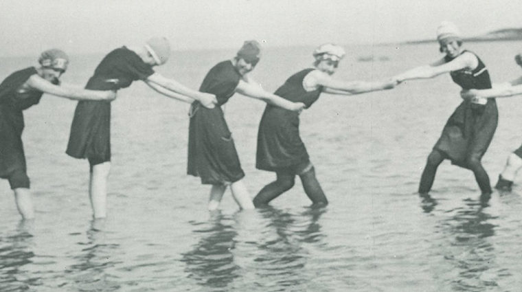 old image of women swimming